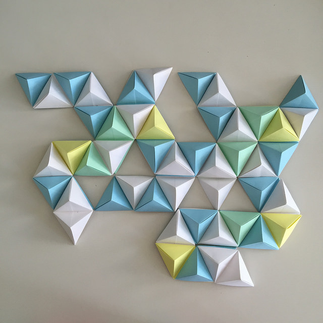 Some Origami Wall Art That Stuck With Me It Was A Pastel Piece Made From Triangles Were Placed Together To Create Minimal Geometric