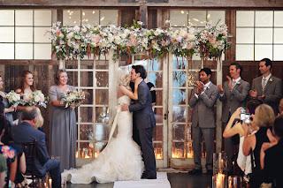 Megan & Tyler kiss at their wedding ceremony
