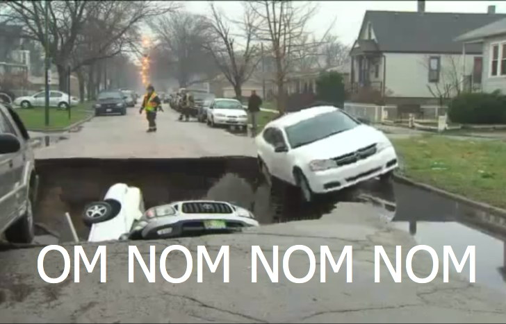 sinkhole-swallow-cars-in-chicago-video.j