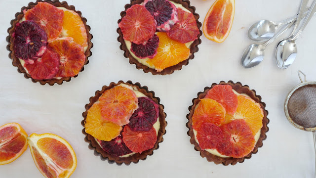 overhead shot of chocolate and blood orange tartlets with mascarpone cream