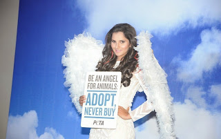 Sania Mirza Latest Pictures in White Dress at PETA Be an Angel for Animal Pictureshoot  35