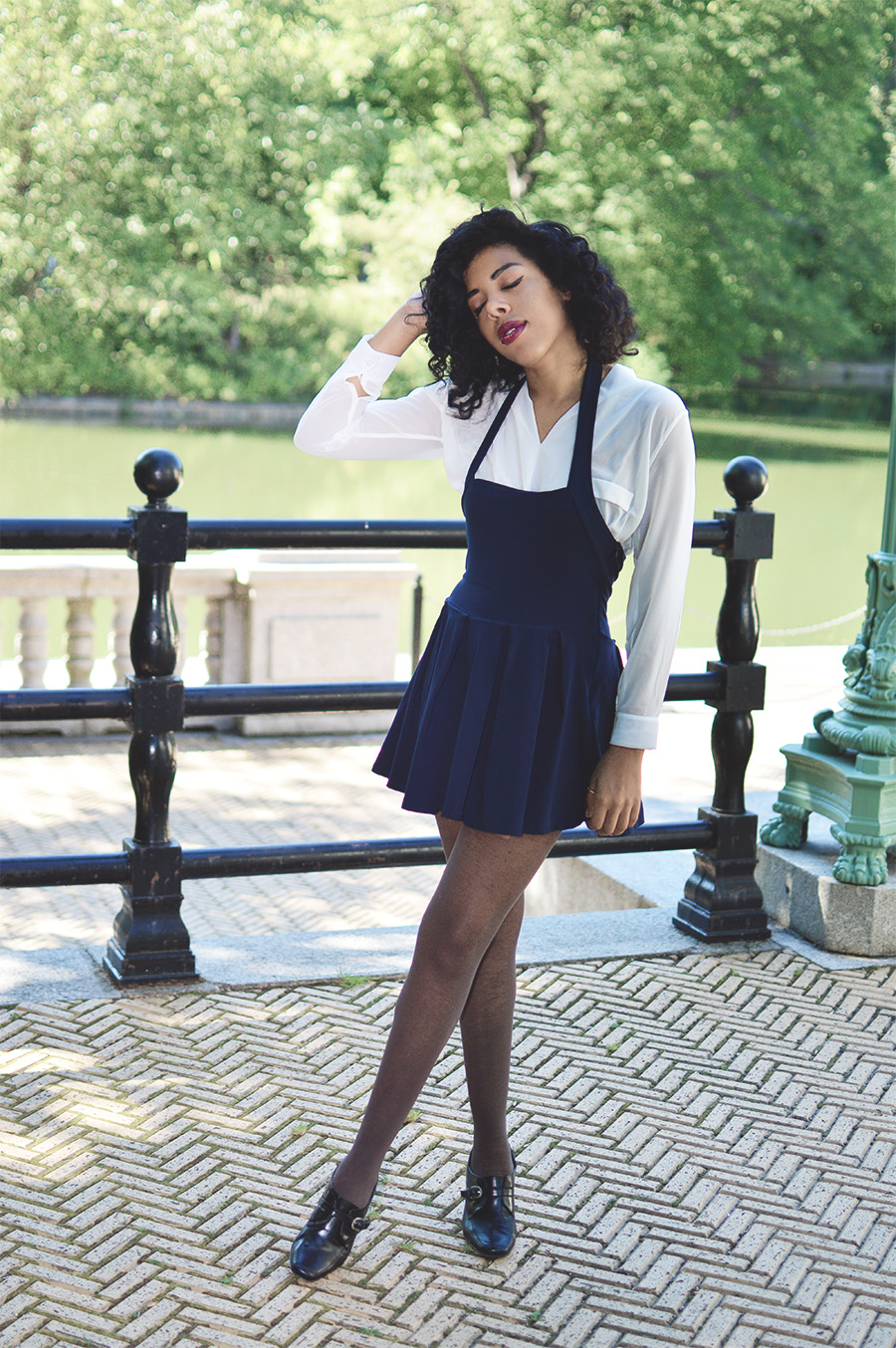 Blipster Indie Fashion Blogger Anais Alexandre of Down to Stars in a white blouse with navy skirt overalls