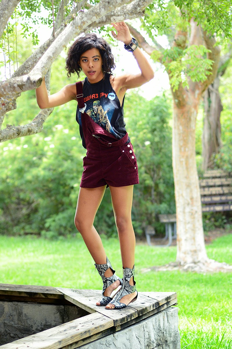 Miami Fashion Blogger and Indie Culture Blogger Anais Alexandre of Down to Stars in a vintage graphic tee with red velvet overalls and silver snakeskin gladiators