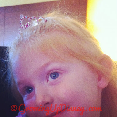 child wearing Disney tiara