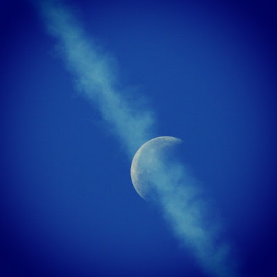 jet contrails over moon