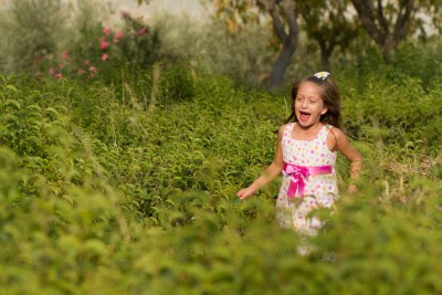 NAMC international montessori congress origins and potential activities girl running in field