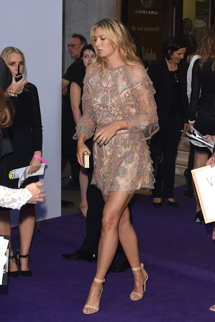 Maria Sharapova stunning leggy poses at WTA party carpet photo 6