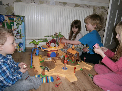 lots of children playing with the large jungle junction playset from flair plastic toys are sturdy and fun