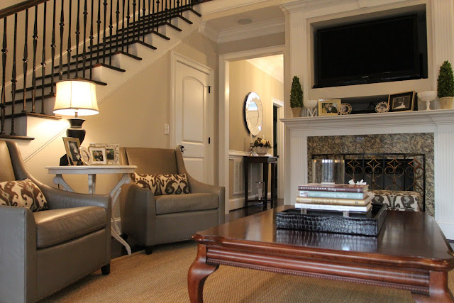 Leather Armchairs: West Elm White Wine Table: Strobler Furnishings  Columbia, SC Ikat Pillows: Etsy Black Lamp: Marshallu0027s Croc Tray: Marshallu0027s
