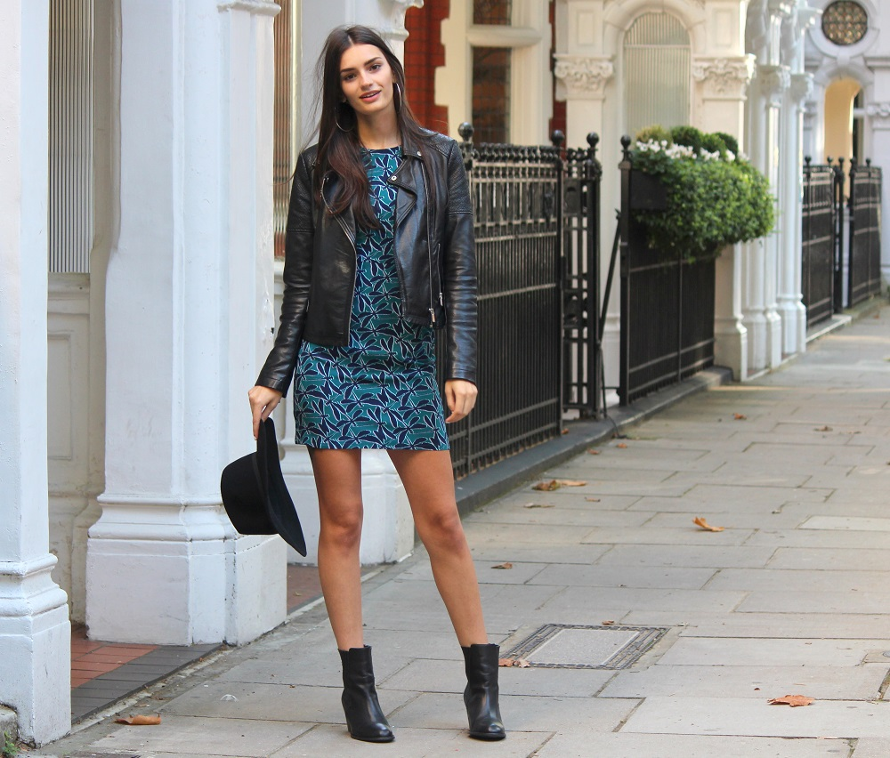 peexo fashion blogger wearing leather jacket and sugarhill boutique dress