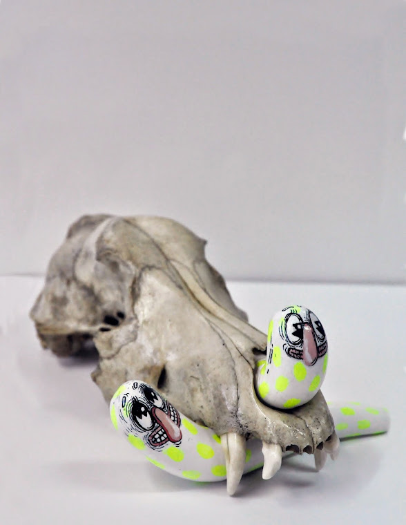 Skull and Worms I, 2014.Dog skull, clay figures, acrylic paint, various dimensions