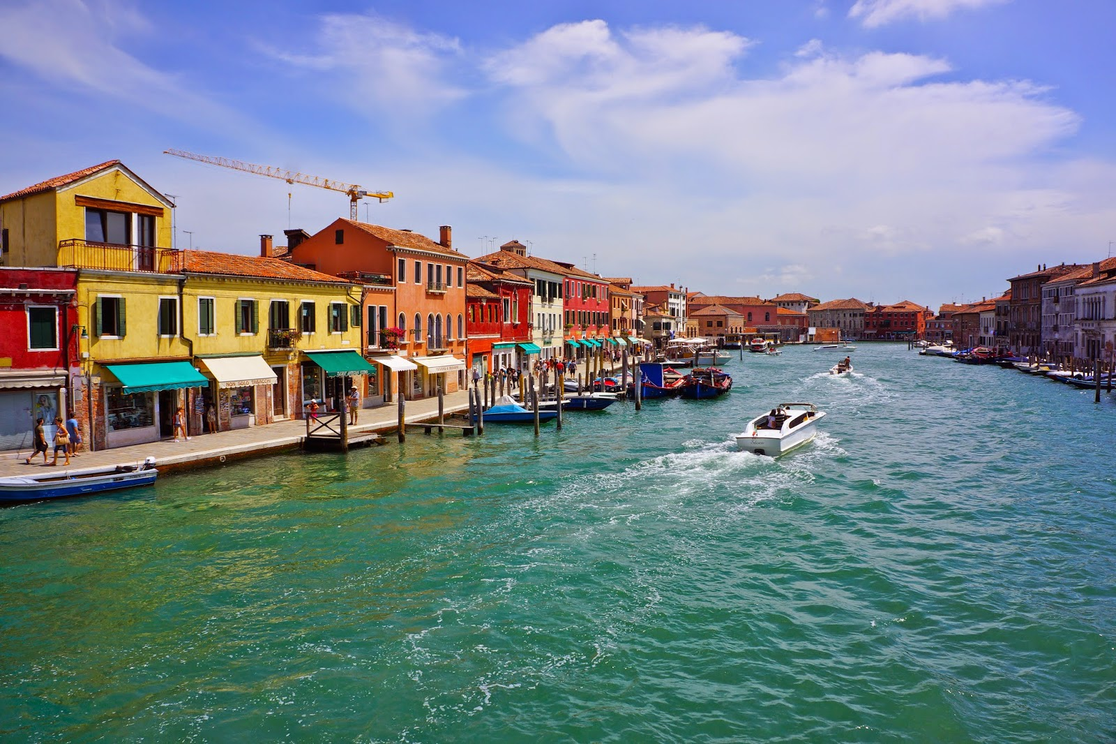 Colorful houses along the canal in Murano, Venice, Italy.