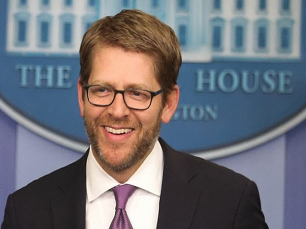 Stubble and Spectacles Specify Jay Carney's First Look This Year