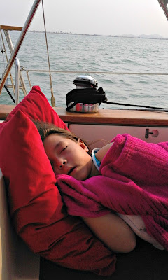 The Tiny Captain asleep on watch during our sailing adventures on the way to Tioman Island Malaysia