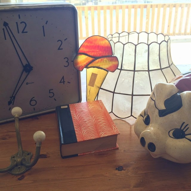 #thriftscorethursday Week 47 | Instagram user: creationsbyrachelw shows off this Thrifting Haul Clock Piggy Bank Lampshade Book Coat Hook