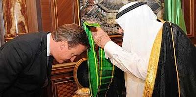Prime minister David Cameron receives the King Abdullah Decoration One from King Abdullah of Saudi Arabia in Jeddah, November 6, 2012.