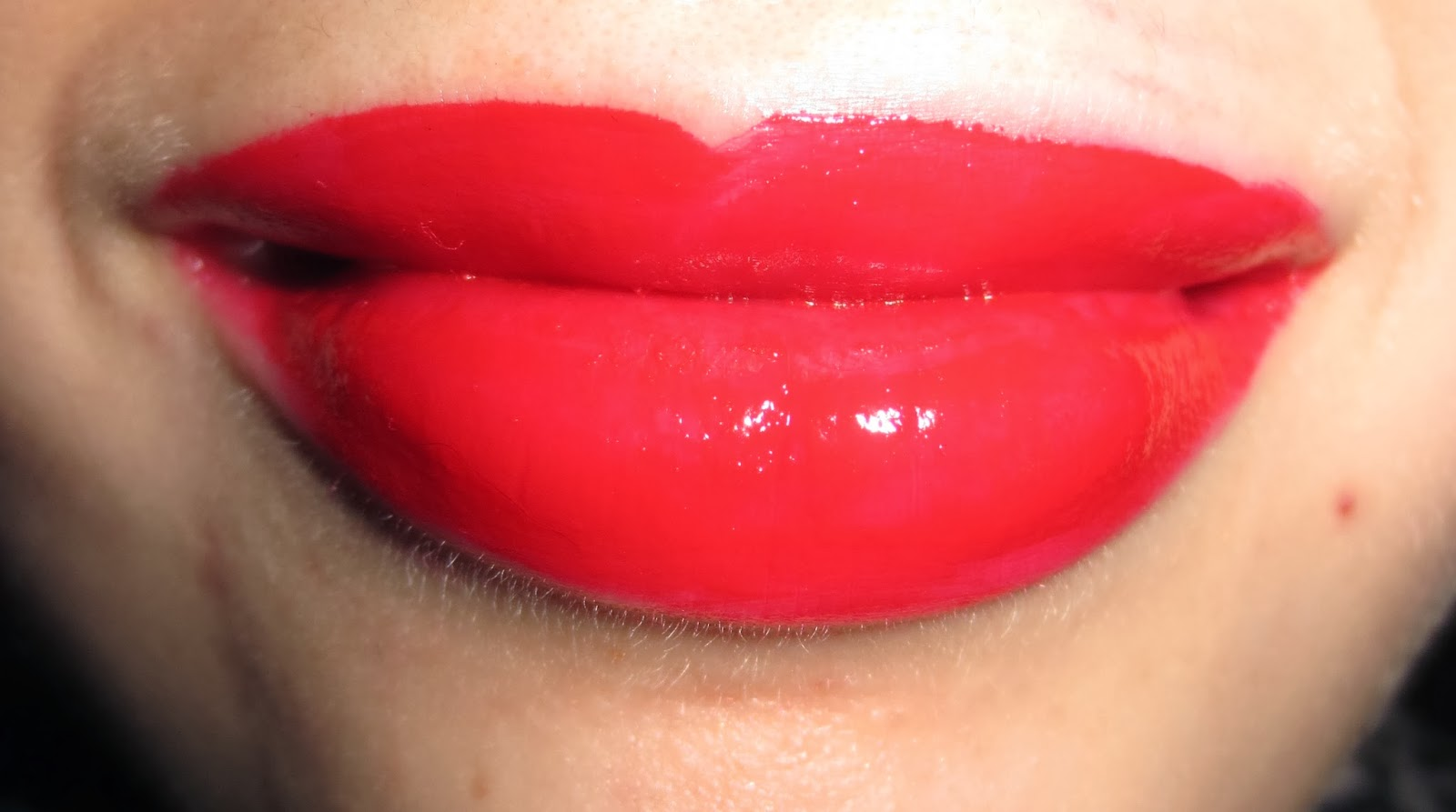 Rimmel Apocalips Lip Lacquer in Big Bang on Lips