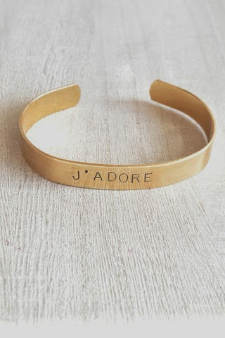 http://www.whitetrufflestudio.com/collections/mother-s-day-collection/products/j-adore-stamped-cuff-bracelet