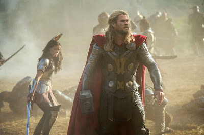 Jamie Alexander and Chris Hemsworth in Thor: The Dark World