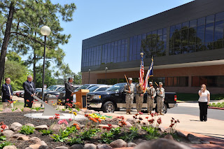 Photo from 2011 Sundial ceremony featuring military color guard, College of Criminal Justice leaders, sundial and singer.