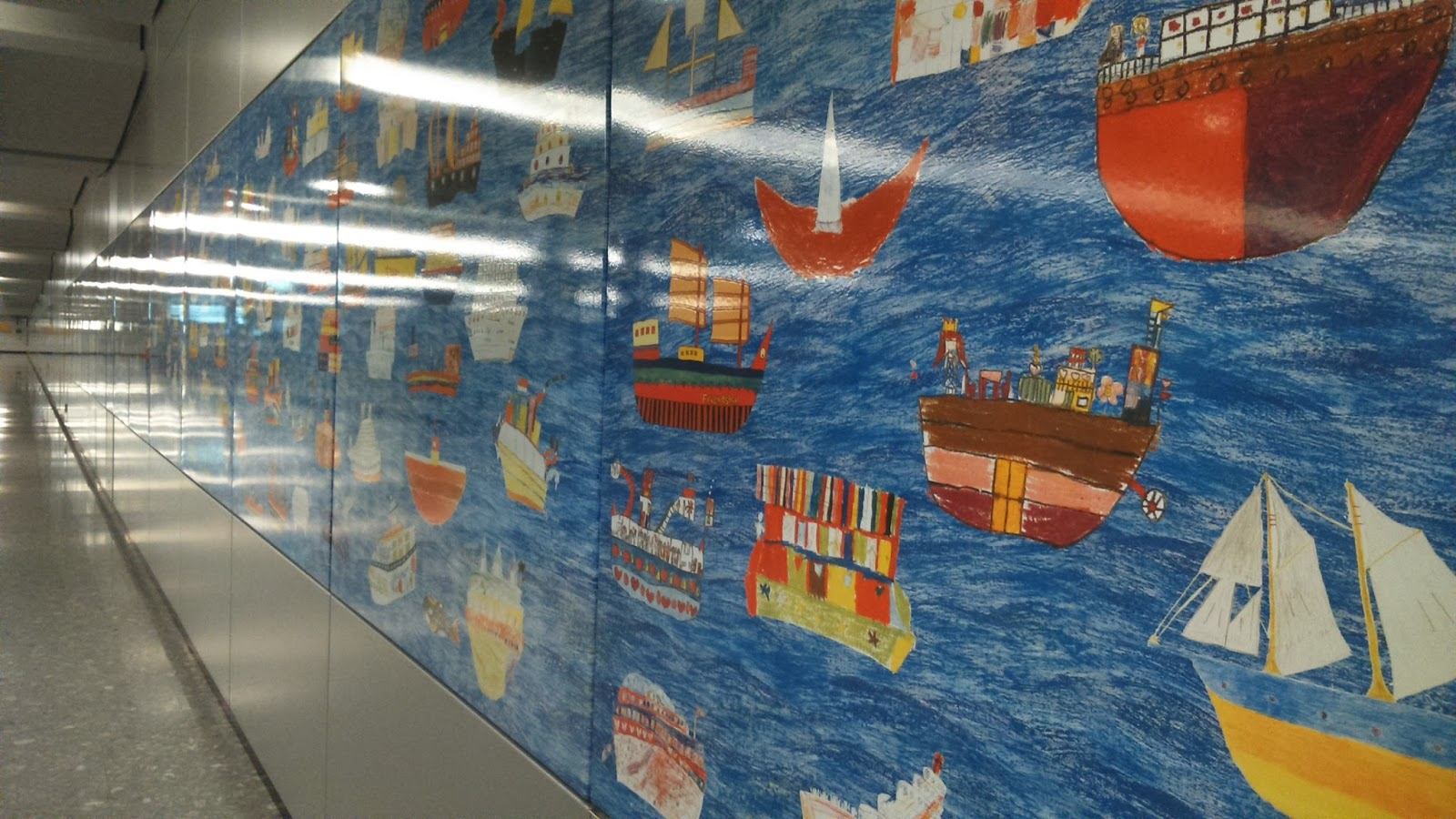 drawing of different types of ships at the concourse level ships range from chinese junks to cargo ships the artwork stretches one end to the end of a