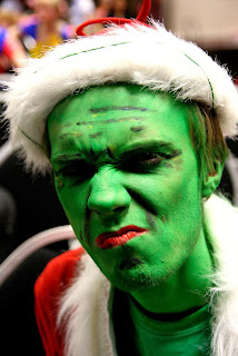 Picture of scowling green faced man in hand made Grinch costume