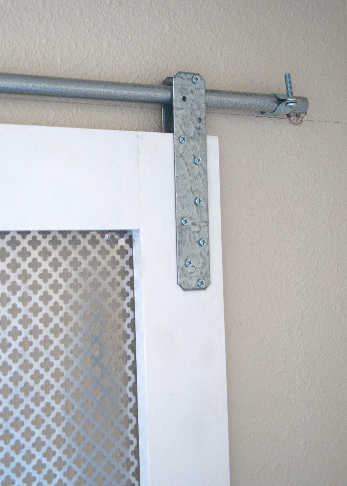 DIY Barn Door Window Cover for the Bathroom - hanging the barn door window cover