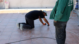 Bekir making sure they will grout the tiles