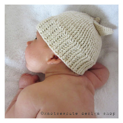 http://www.ravelry.com/patterns/library/apple-of-my-eye-baby-hat