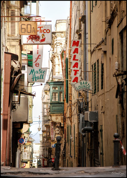 View of a backstreet in Valetta, Malta with bar signs