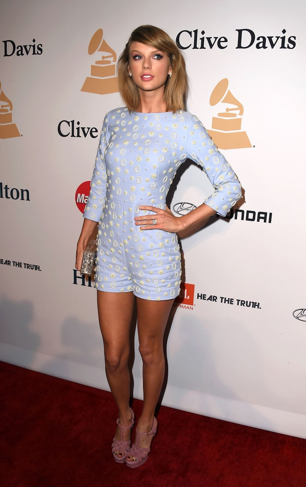 Taylor Swift shows off legs in a blue romper at the Annual Clive Davis Pre-Grammys Gala in Beverly Hills