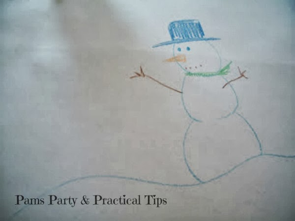 snowman drawings on a table cover for snowman party