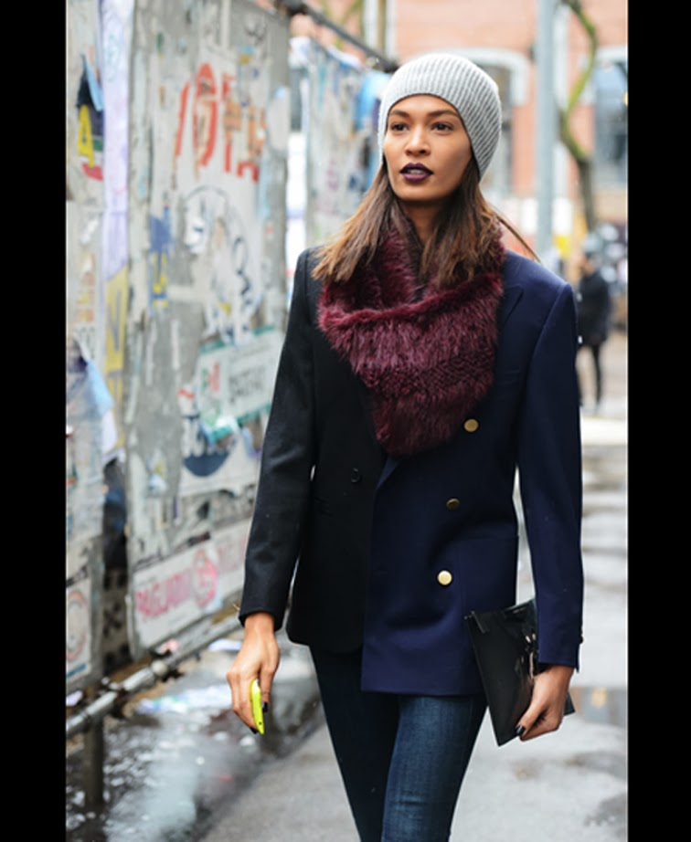 Joan Smalls model off duty street style burgundy fur scarf + lip