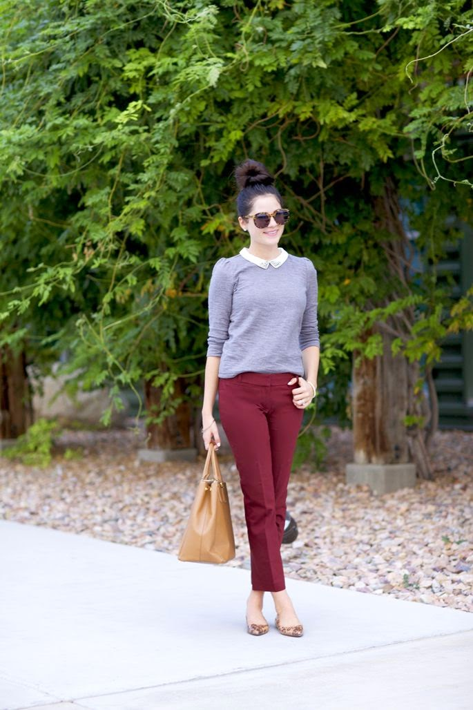 A grey sweater tones down bright trousers. A tan leather tote is roomy enough to hold all your daily essentials