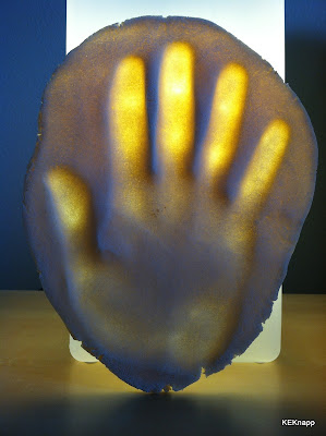 Created permanent impression of my right hand using homemade dough.... love the glow