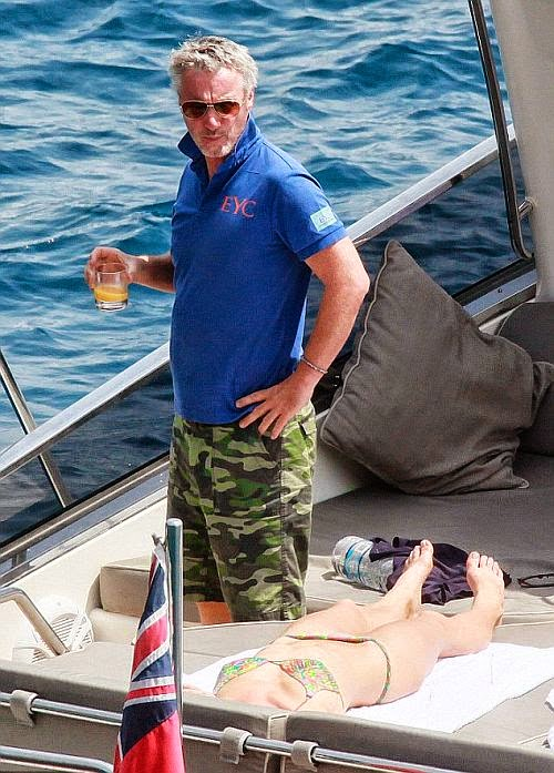 Eddie Irvine just slipped into some skin blue top and a matching army trunks as he enjoyed a vacation in Italy on Sunday, June 28, 2014.