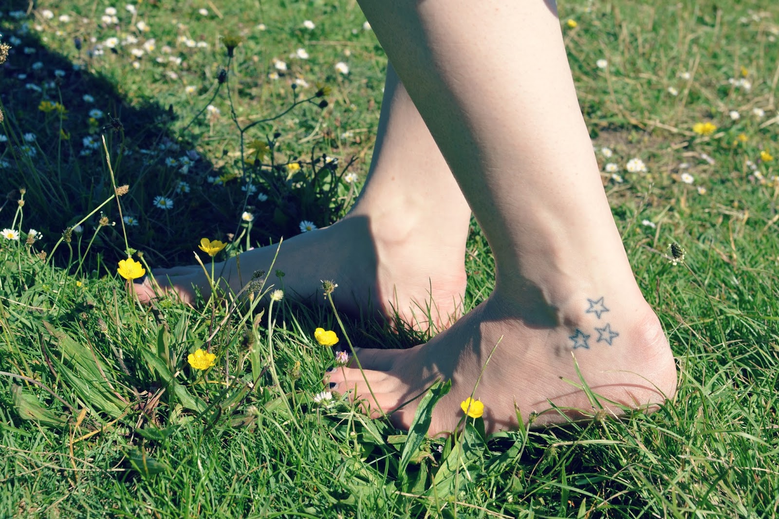 bare feet tattoos flowers festival