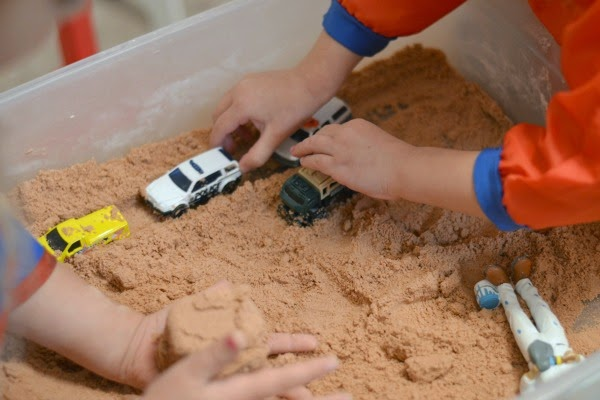Homemade kinetic sand- don't waste your money on the store bought stuff when you can easily make this recipe at home! Squishy, mold-able, & lots of fun