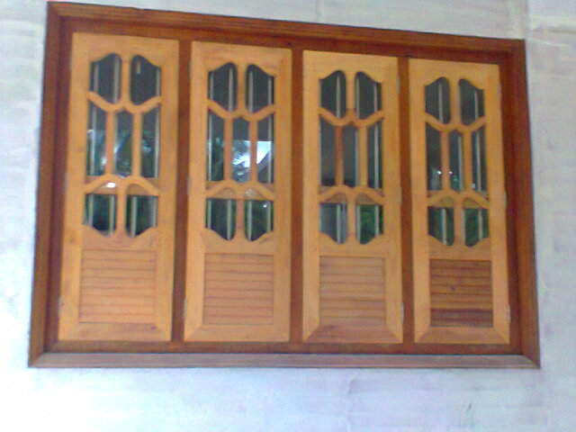 Carpenter work ideas and kerala style wooden decor wooden for Wood window door design
