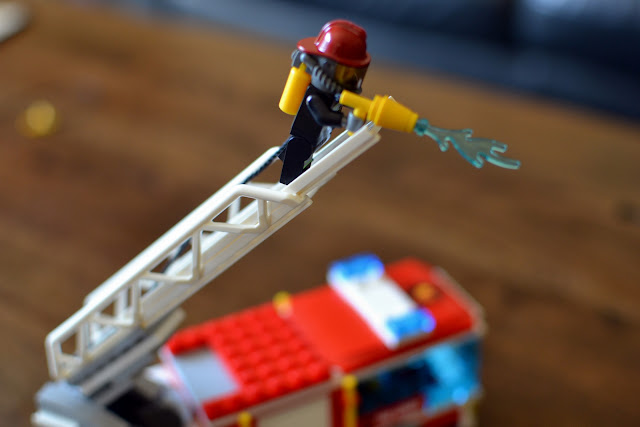 LEGO City Fire Truck fighting fires up the extendable ladder