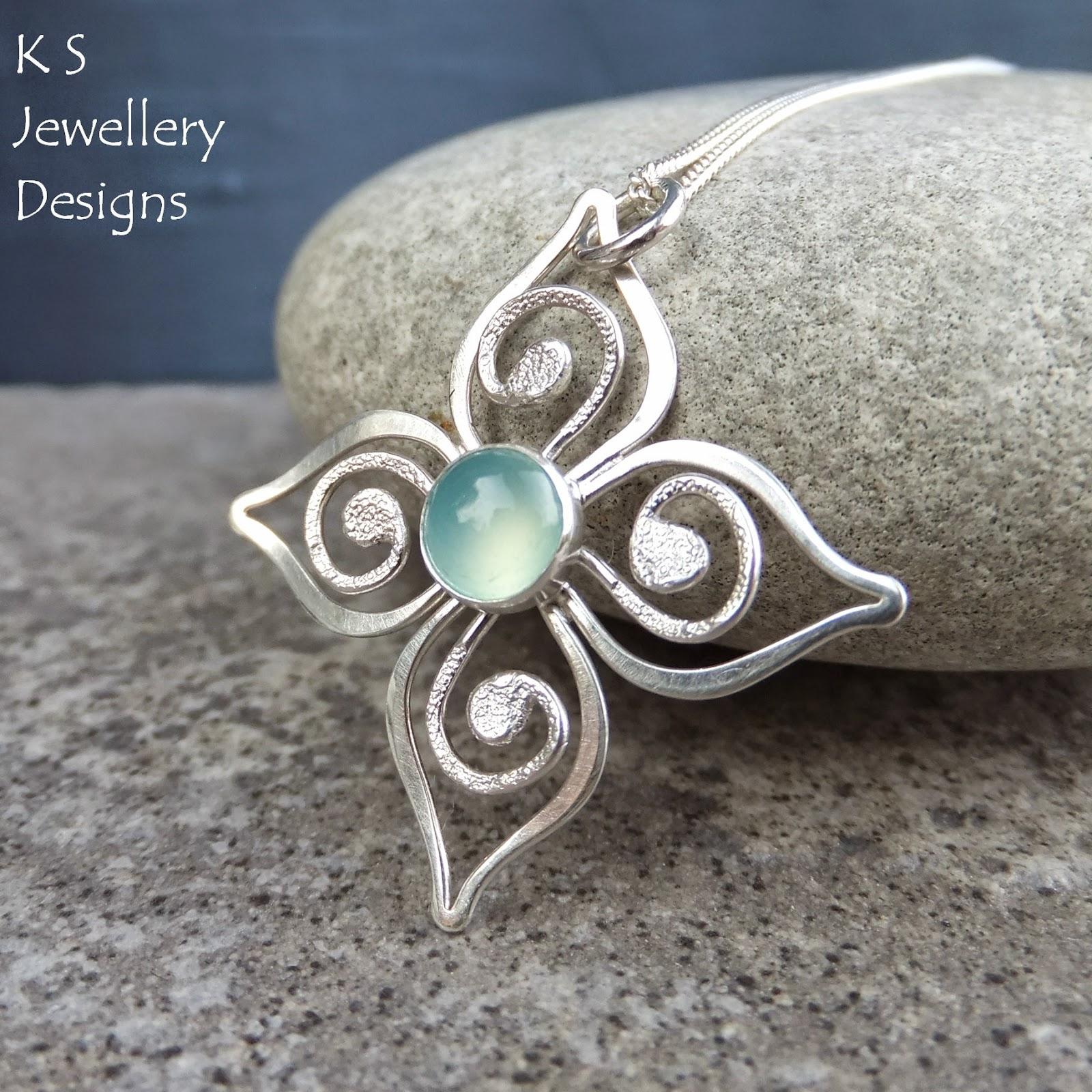 http://ksjewellerydesigns.co.uk/ourshop/prod_3583972-Aqua-Chalcedony-Sterling-Silver-Flower-Pendant-Swirl-Blossom.html