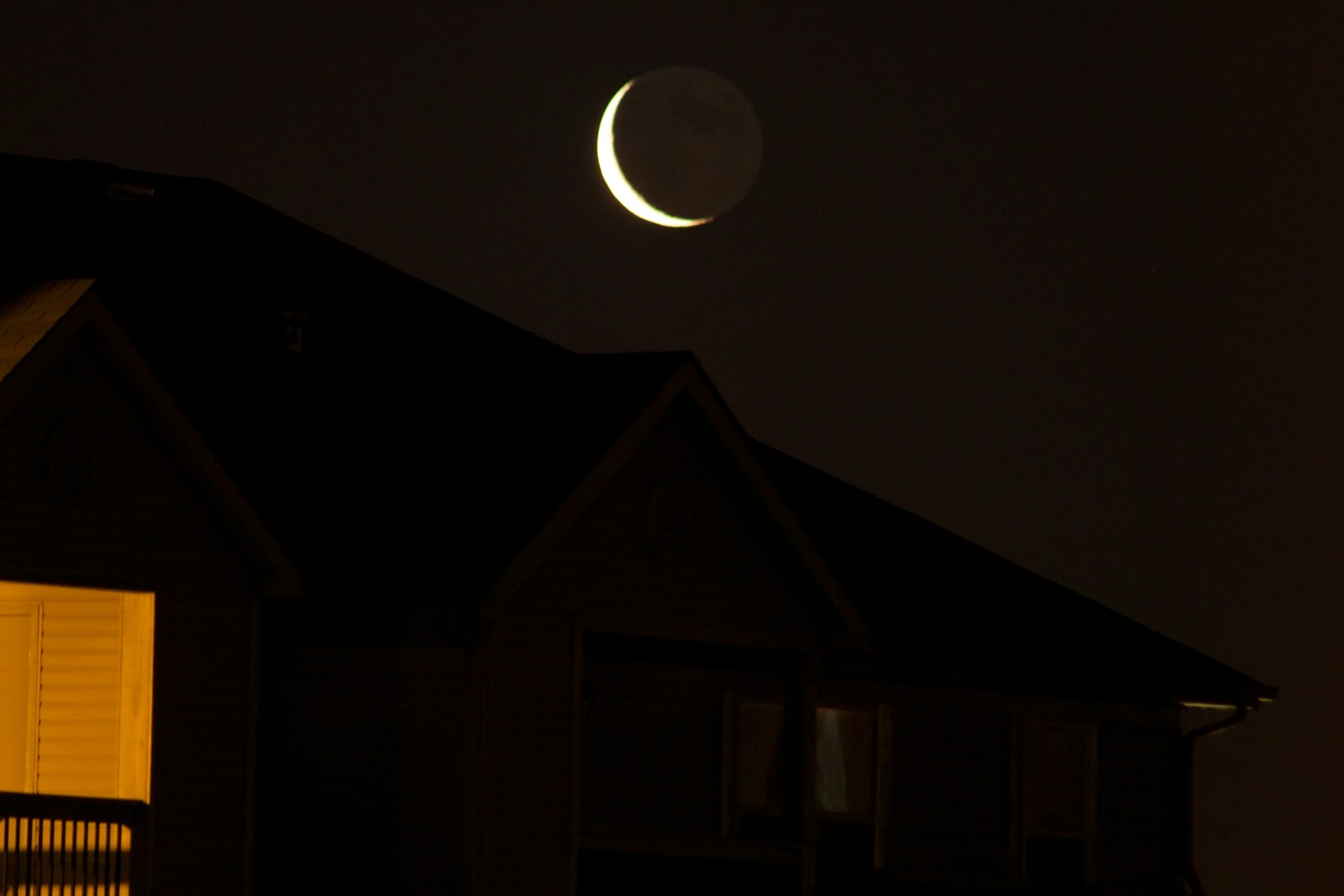 crescent moon over roof