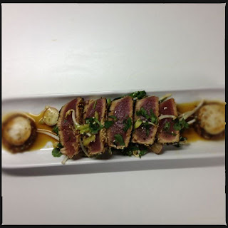 Seared tuna with tuna tartare, scallops and pak choi salad