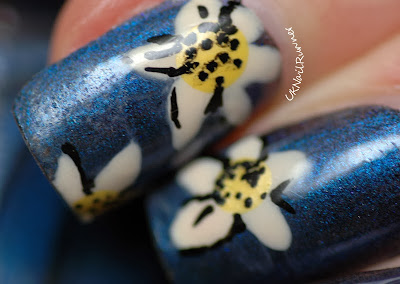 Nelly Polish Night Sky with floral nail art