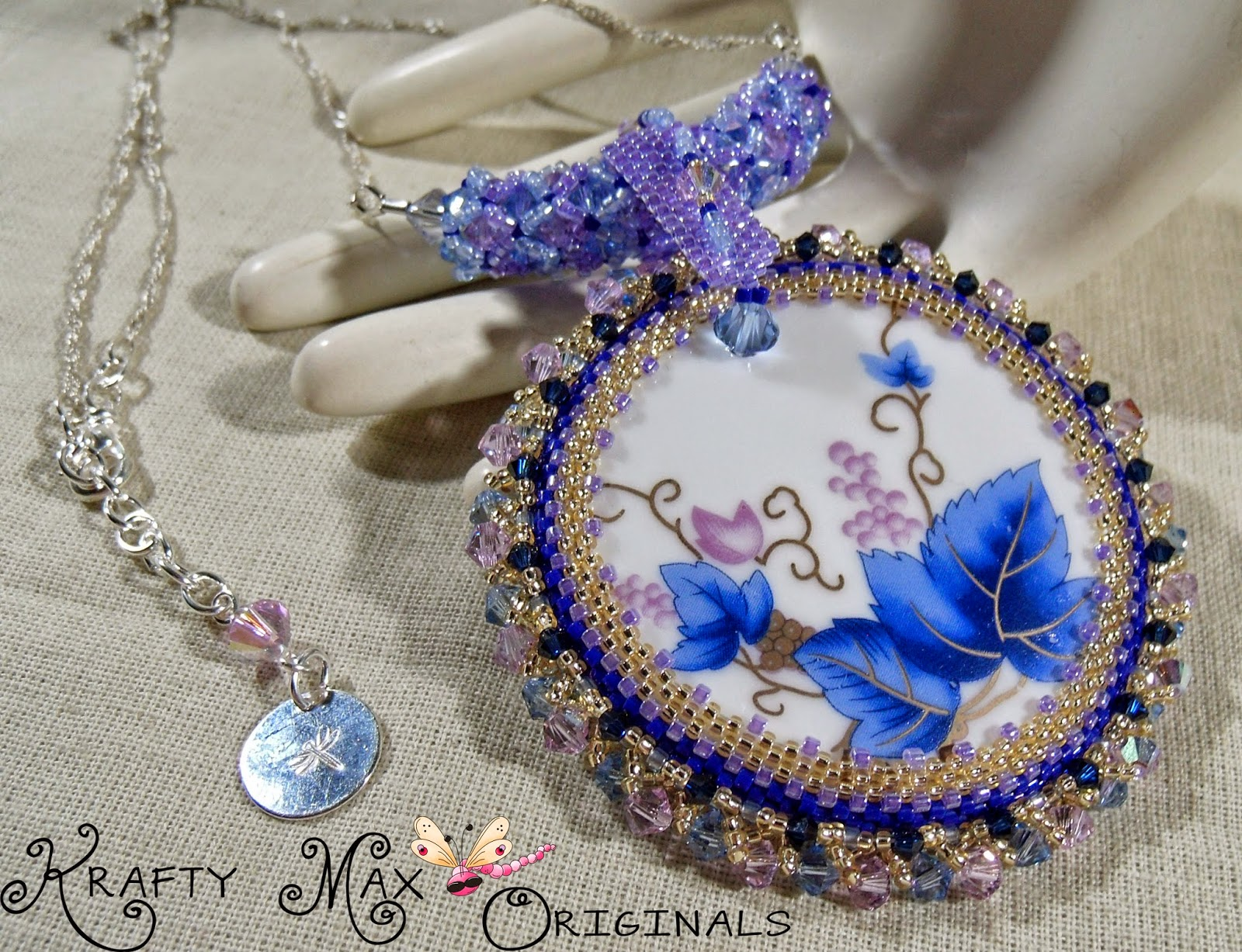 http://www.artfire.com/ext/shop/product_view/KraftyMax/9750132/ms_marrianne_blue_bell_-_handmade_beadwoven_swarovski_crystal_set/handmade/jewelry/necklaces/beadwoven