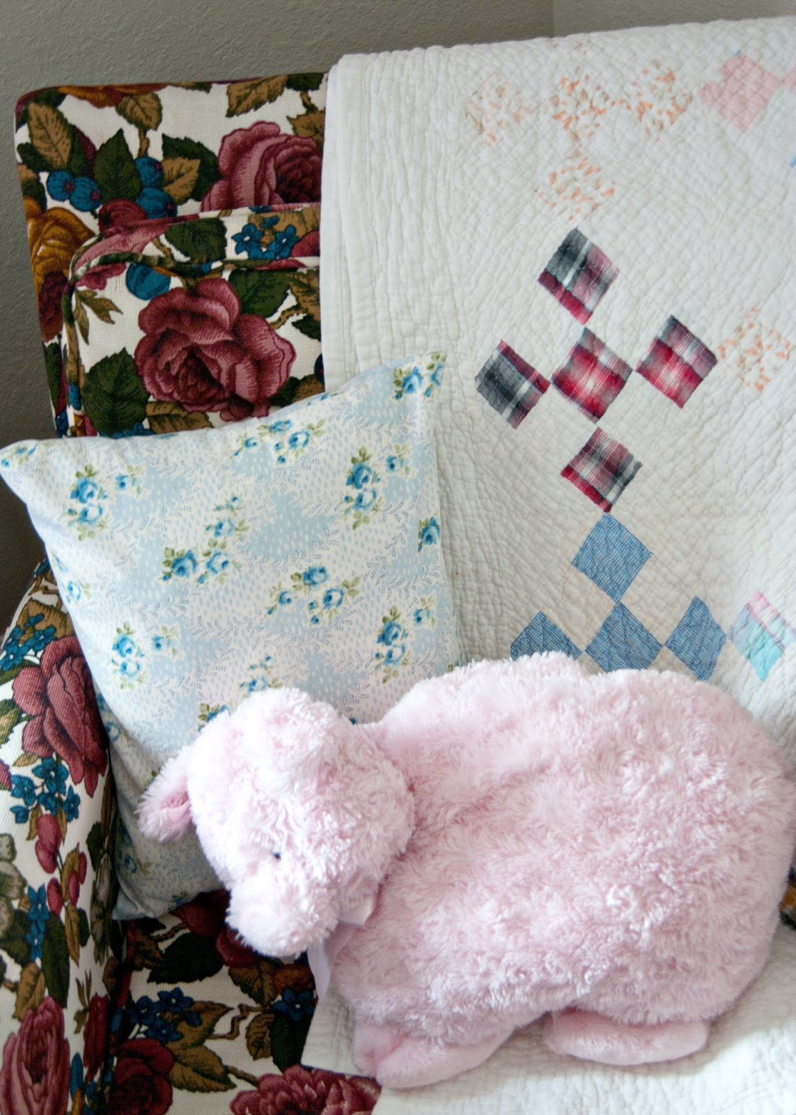 Granny chic chair, vintage baby quilt and stuffed pig