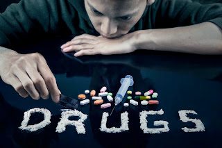 Teenagers signs sits overlooking a stash of drugs.