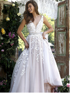 http://www.sherrylondon.co.uk/fancy-sleevelessv-neck-ivory-lace-overlay-nude-tulle-long-coast-prom-dress-wityh-crystal-ribbon-p-14175.html