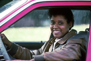 african woman in car