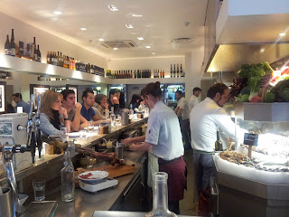 The L-shaped counter and open kitchen at Barrafina, Soho